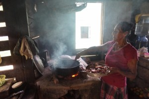Beneficiary with her traditional cookstove